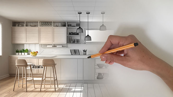 Architect interior designer concept: hand drawing a design interior project while the space becomes real, modern white and wooden kitchen with island and stools