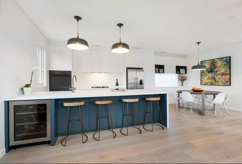 1.blue-and-white-handleless-kitchen-with-caesarstone-benchtop